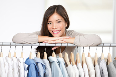 Woman leaning on clothes rail